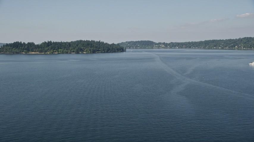 5K aerial video fly over Lake Washington to approach Mercer Island, Washington Aerial Stock Footage | AX47_003