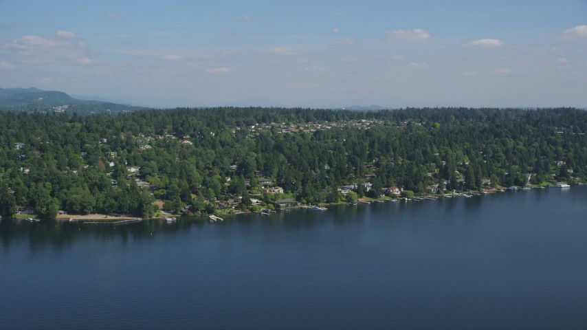 5K stock footage aerial video of waterfront homes on the shore of Lake Washington, Mercer Island, Washington Aerial Stock Footage | AX47_006