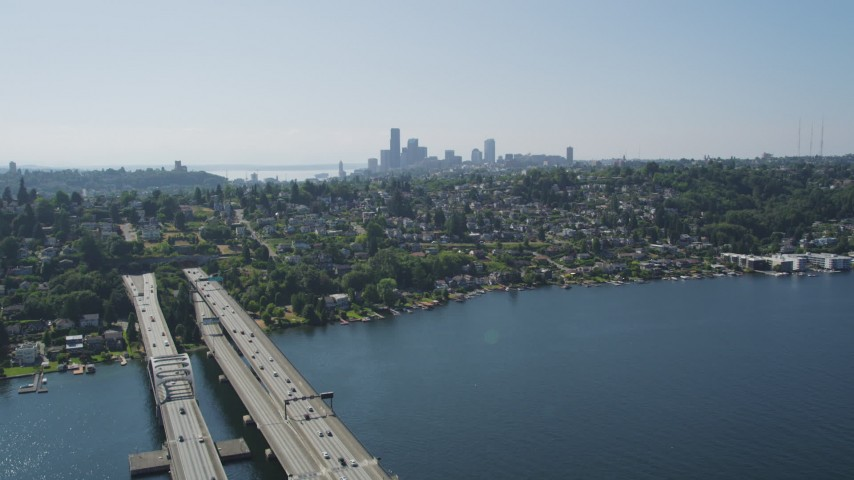 5K stock footage aerial video fly over light bridge traffic to reveal the Downtown Seattle skyline, Washington Aerial Stock Footage | AX47_013