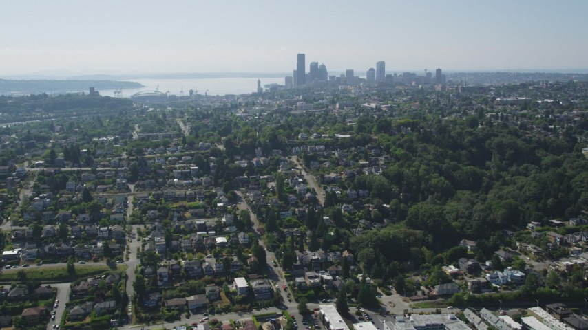 5K stock footage aerial video of Downtown Seattle skyline seen from suburban neighborhoods by the shore of Lake Washington, Washington Aerial Stock Footage | AX47_014