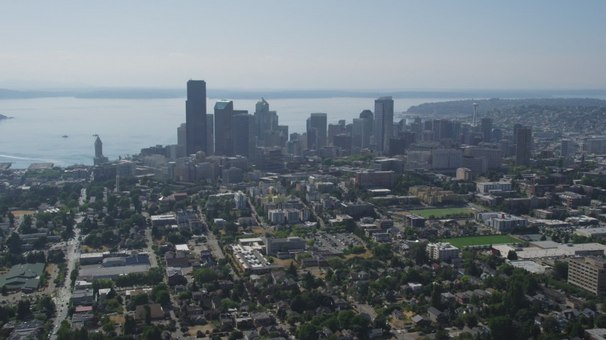 5K stock footage aerial video fly west toward the Downtown Seattle skyline, Washington Aerial Stock Footage | AX47_017
