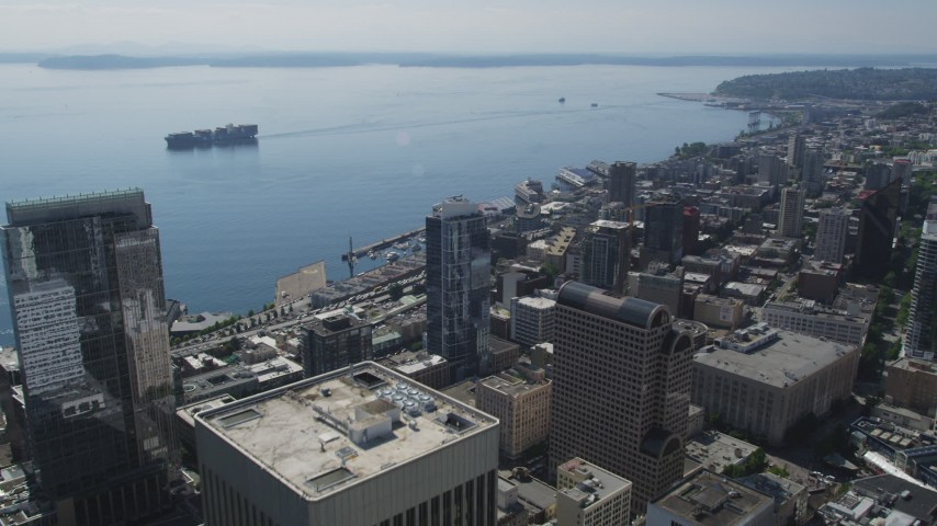 5K stock footage aerial video fly toward the Central Waterfront, reveal skyscraper, Downtown Seattle, Washington Aerial Stock Footage | AX47_021