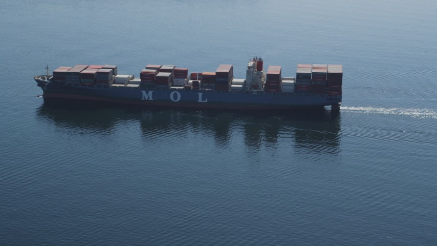 5K stock footage aerial video track a cargo ship sailing Elliott Bay, Seattle, Washington Aerial Stock Footage | AX47_024