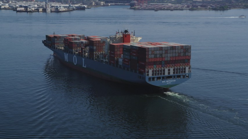 5K stock footage aerial video of orbiting a cargo ship sailing Elliott Bay and reveal two tugboats, Seattle, Washington Aerial Stock Footage | AX47_025