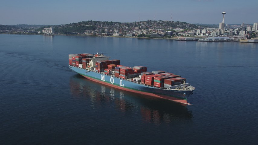 5K stock footage aerial video orbit of a cargo ship sailing Elliott Bay, Seattle, Washington Aerial Stock Footage | AX47_027