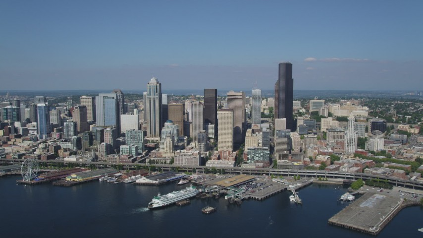 5K stock footage aerial video approach Downtown Seattle skyline and fly over the Seattle Ferry Terminal on the Waterfront, Washington Aerial Stock Footage | AX47_037