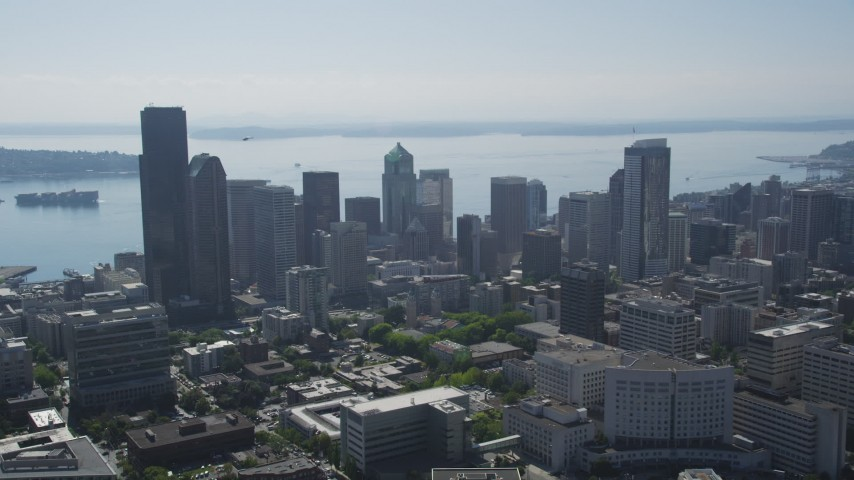 5K stock footage aerial video approach high-rises and skyscrapers in Downtown Seattle, Washington, with Elliot Bay in background Aerial Stock Footage | AX47_044