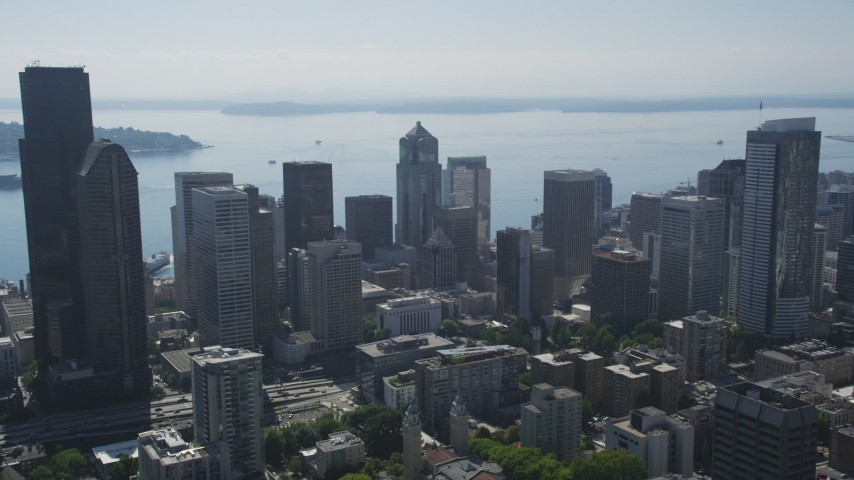 5K stock footage aerial video fly over downtown to approach 1201 Third Avenue Tower in Downtown Seattle, Washington Aerial Stock Footage | AX47_045