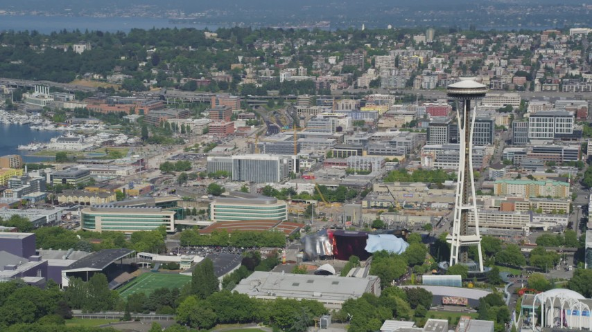 5K stock footage aerial video of Memorial Stadium, Museum of Pop Culture, and the Space Needle in Downtown Seattle, Washington Aerial Stock Footage | AX47_049
