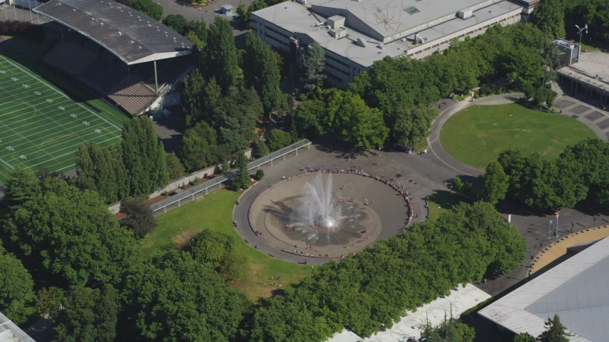 5K stock footage aerial video of orbiting the Seattle Center Fountain; Downtown Seattle, Washington Aerial Stock Footage   AX47_052