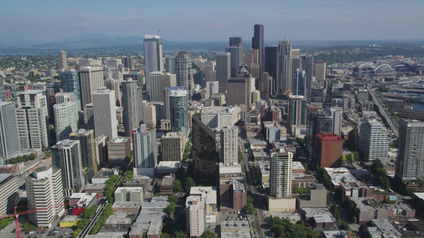 5K stock footage aerial video fly south to approach skyscrapers and city buildings, Downtown Seattle, Washington Aerial Stock Footage | AX47_054