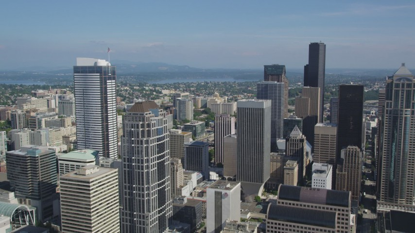 5K stock footage aerial video fly over downtown high-rises to approach taller skyscrapers in Downtown Seattle, Washington Aerial Stock Footage | AX47_055