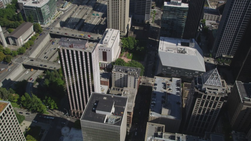 5K stock footage aerial video fly over Downtown Seattle, and tilt to reveal an intersection beside the Seattle Public Library, Washington Aerial Stock Footage | AX47_056