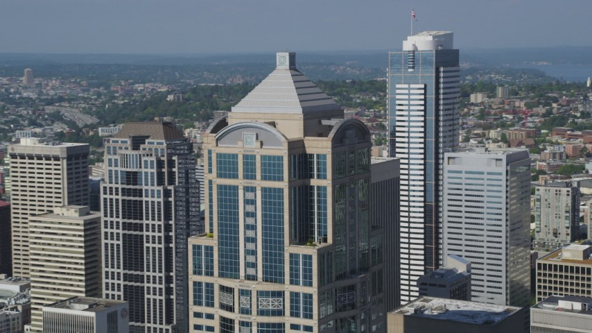 5K stock footage aerial video of orbiting the top of 1201 Third Avenue Tower, Downtown Seattle, Washington Aerial Stock Footage | AX47_060