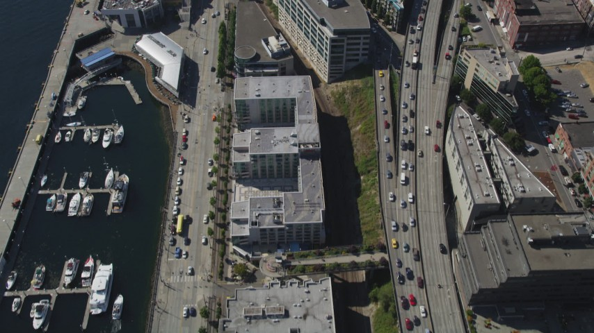 5K stock footage aerial video of bird's eye of piers and apartment buildings on the Central Waterfront in Downtown Seattle, Washington Aerial Stock Footage | AX47_061