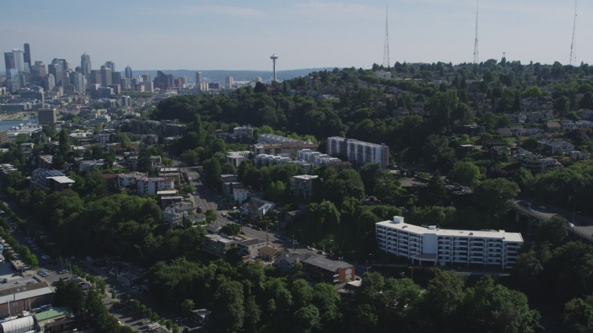 5K stock footage aerial video approach and fly over bridge spanning Lake Union, reveal Downtown Seattle skyline, Washington Aerial Stock Footage AX47_068 | Axiom Images
