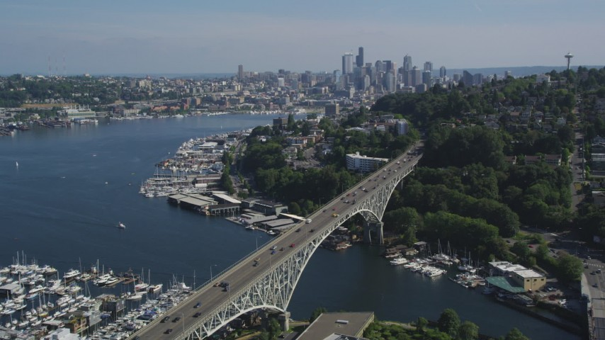 5K stock footage aerial video fly over Aurora Bridge and Lake Union marinas to approach the Downtown Seattle skyline, Washington Aerial Stock Footage | AX47_073
