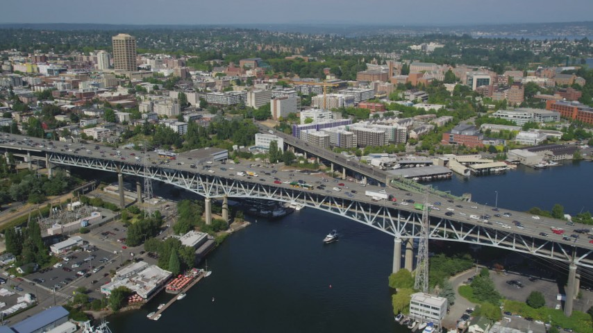 5K stock footage aerial video orbit heavy traffic on the Ship Canal Bridge; Seattle, Washington Aerial Stock Footage AX47_077 | Axiom Images
