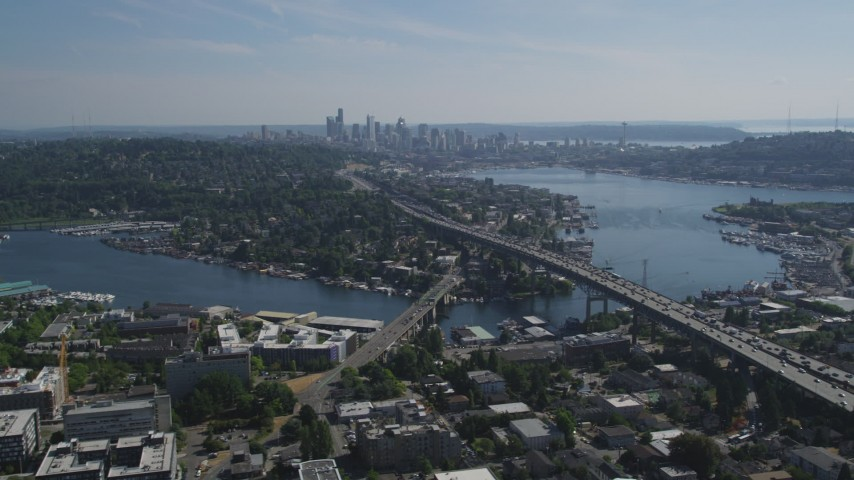 5K stock footage aerial video fly away from Ship Canal Bridge and tilt to reveal Lake Union and the skyline of Downtown Seattle, Washington Aerial Stock Footage | AX47_078