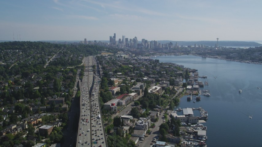 5K stock footage aerial video fly over bridge and follow the shore of Lake Union toward Downtown Seattle skyline, Washington Aerial Stock Footage | AX47_080