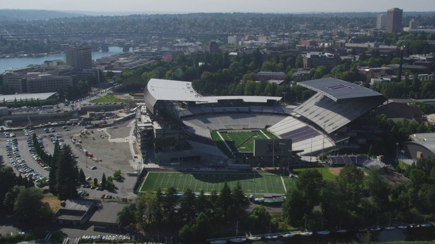 5K stock footage aerial video flyby Husky Stadium at the University of Washington, Seattle Aerial Stock Footage | AX47_086