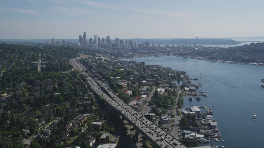 5K stock footage aerial video fly over the Ship Canal Bridge to approach the Downtown Seattle skyline and Lake Union, Washington Aerial Stock Footage | AX47_090