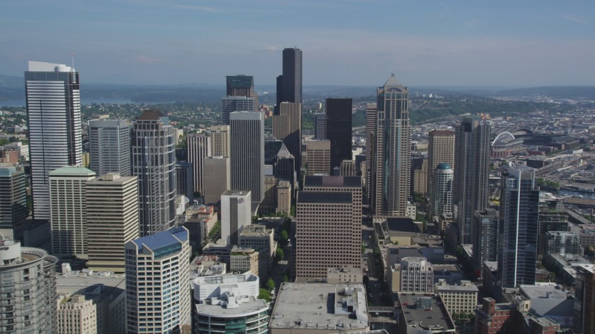 5K stock footage aerial video fly by tall skyscrapers and city buildings in Downtown Seattle, Washington Aerial Stock Footage | AX47_096