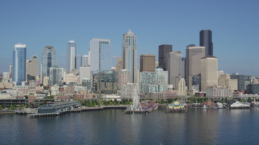 5K stock footage aerial video flyby skyscrapers to reveal the Seattle Aquarium and the Seattle Great Wheel on the Central Waterfront, Downtown Seattle, Washington Aerial Stock Footage | AX47_097