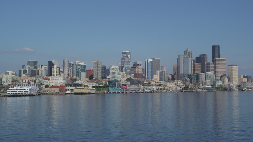 5K stock footage aerial video of low altitude approach the Seattle Waterfront piers and skyline, Downtown Seattle, Washington Aerial Stock Footage | AX47_118