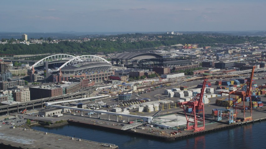 5K stock footage aerial video of cargo cranes near CenturyLink Field and Safeco Field in Downtown Seattle, Washington Aerial Stock Footage | AX47_121