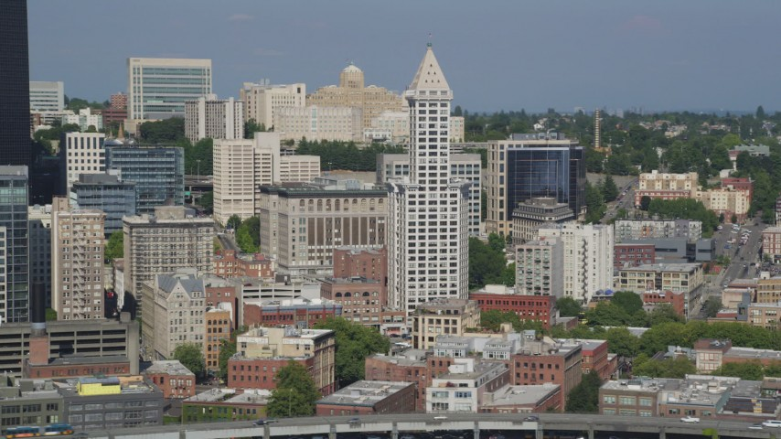 5K stock footage aerial video flyby Smith Tower and city buildings in Downtown Seattle, Washington Aerial Stock Footage | AX47_122