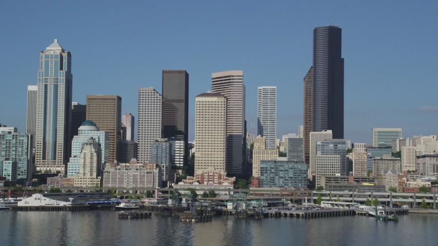 5K stock footage aerial video of the Downtown Seattle skyline and Central Waterfront seen from Elliott Bay, Washington Aerial Stock Footage | AX47_123