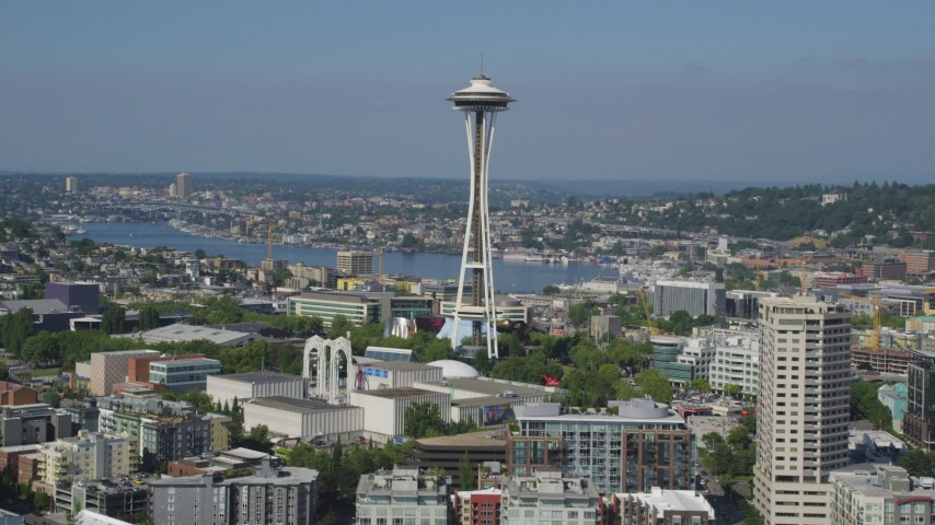 5K stock footage aerial video ascend and approach the world famous Space Needle in Downtown Seattle, Washington Aerial Stock Footage | AX47_126