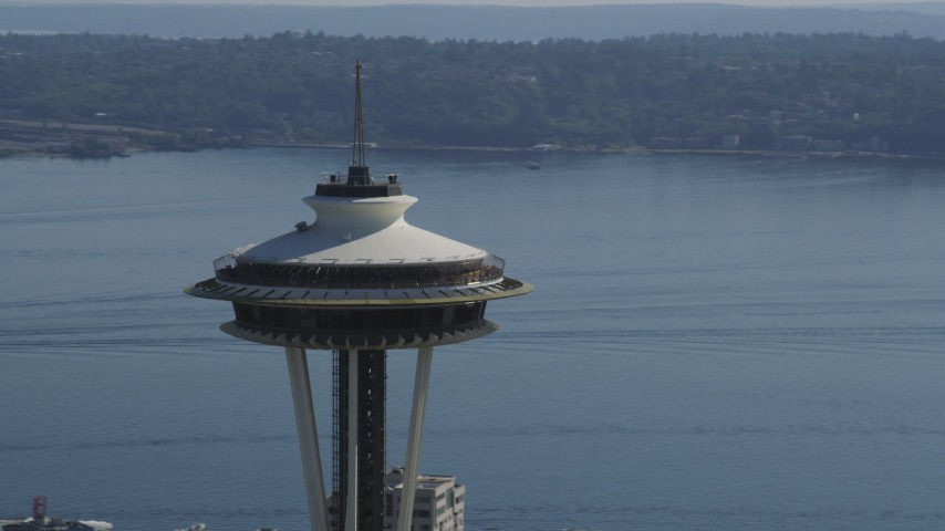 5K stock footage aerial video of orbiting the top of the Space Needle with Elliott Bay in the background, Downtown Seattle, Washington Aerial Stock Footage | AX47_128