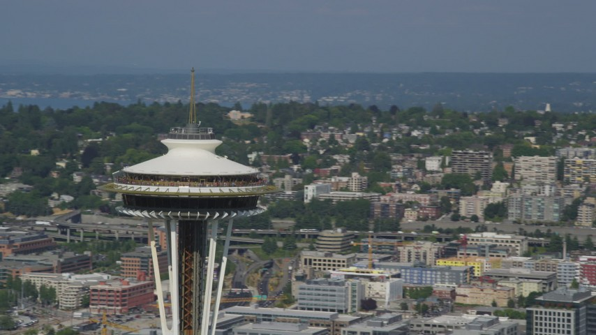 5K stock footage aerial video circle the top of the famous Space Needle, with lake and skyscrapers in the background, Downtown Seattle, Washington Aerial Stock Footage | AX47_131
