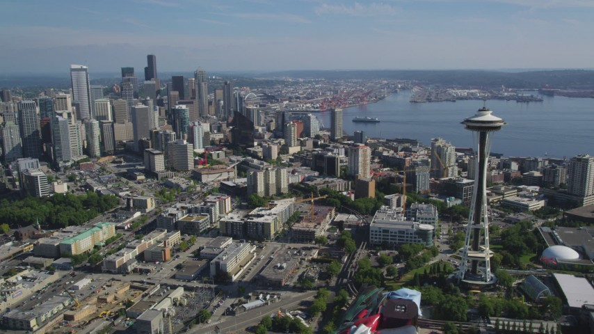 5K stock footage aerial video of the world famous Seattle Space Needle and skyscrapers in Downtown Seattle, Washington Aerial Stock Footage | AX47_133