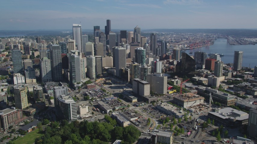 5K stock footage aerial video fly south to approach skyscrapers and city buildings, Downtown Seattle, Washington Aerial Stock Footage | AX47_134