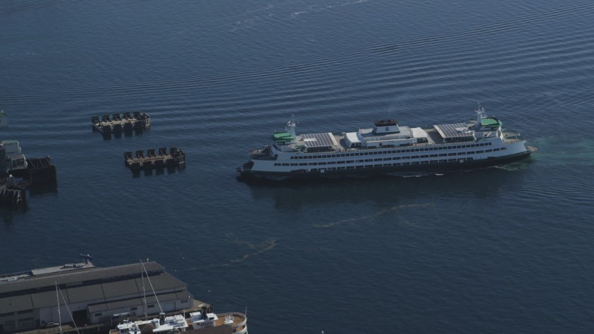 5K stock footage aerial video of ferry approaching the Seattle Ferry Terminal in Downtown Seattle, Washington Aerial Stock Footage | AX47_137