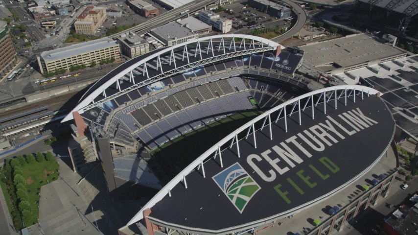 5K stock footage aerial video approach CenturyLink Field and tilt to a bird's eye view of the field, Downtown Seattle, Washington Aerial Stock Footage | AX47_139