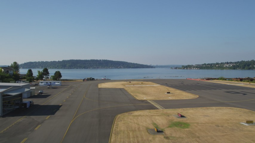5K stock footage aerial video lift off from Renton Municipal Airport and fly over Lake Washington, Seattle, Washington Aerial Stock Footage | AX48_001
