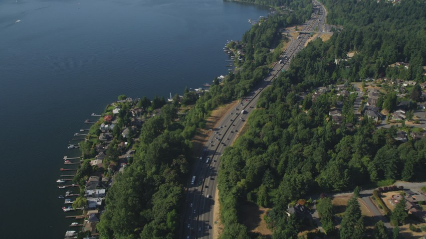 5K stock footage aerial video of flying over light traffic on I-405 and lakeside homes with docks, Bellevue, Washington Aerial Stock Footage | AX48_006