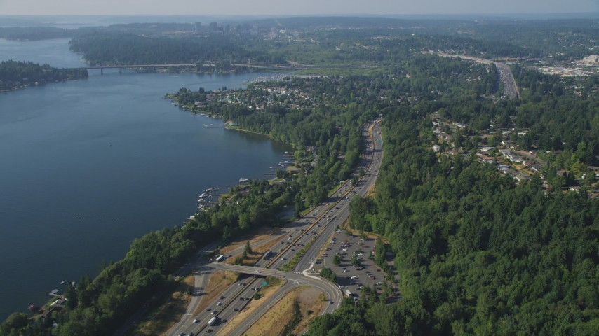 5K aerial video flyby I-405 through a lakeside residential area on the shore of Lake Washington, Bellevue, Washington Aerial Stock Footage | AX48_007