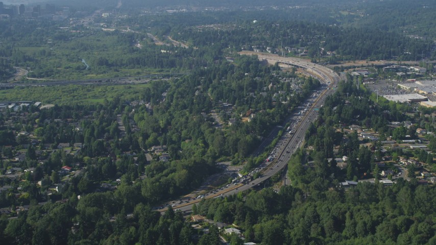 5K aerial video of I-405 with traffic congestion beside a residential neighborhood, Bellevue, Washington Aerial Stock Footage | AX48_008
