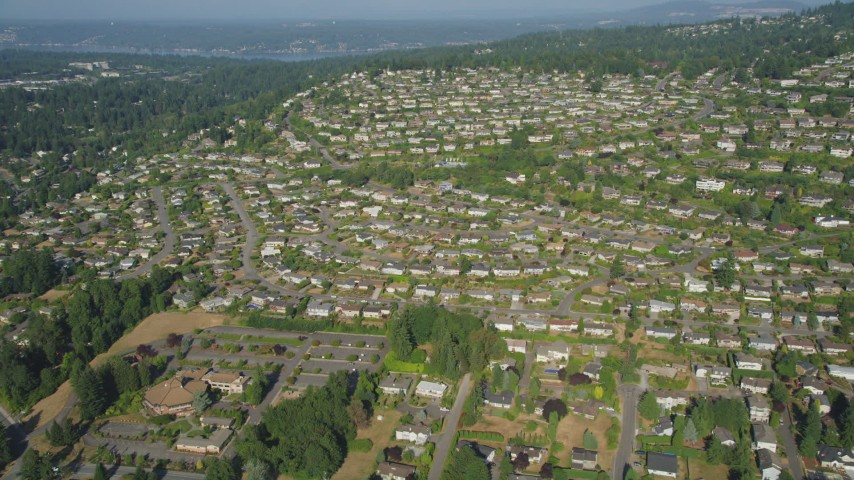 5K stock footage aerial video of flying over rows of suburban tract homes in Bellevue, Washington Aerial Stock Footage | AX48_009