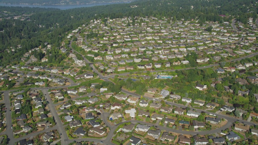 5K aerial video of flying over tract homes in a suburban neighborhood, Bellevue. Washington Aerial Stock Footage | AX48_010