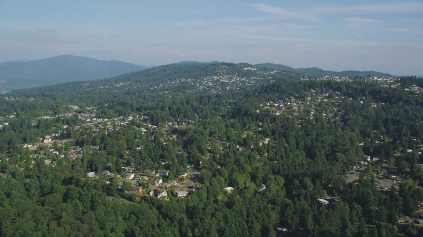 5K stock footage aerial video of passing hillside suburban homes with lush trees, Bellevue, Washington Aerial Stock Footage | AX48_012