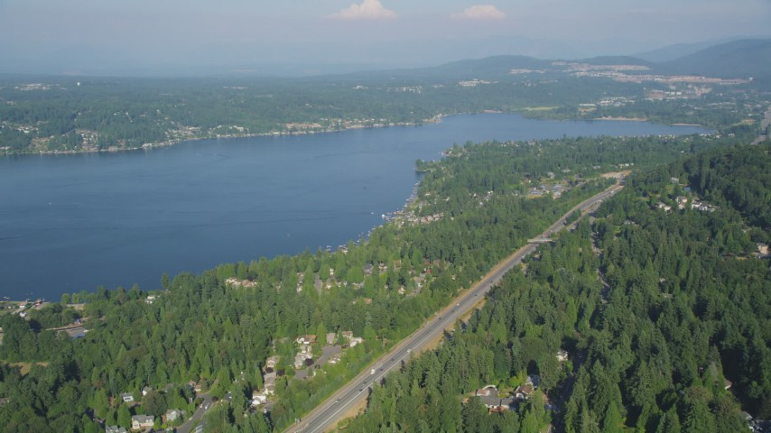 5K stock footage aerial video fly over light traffic on I-90 to approach lakeside homes on the shore of Lake Sammamish in Issaquah, Washington Aerial Stock Footage | AX48_014
