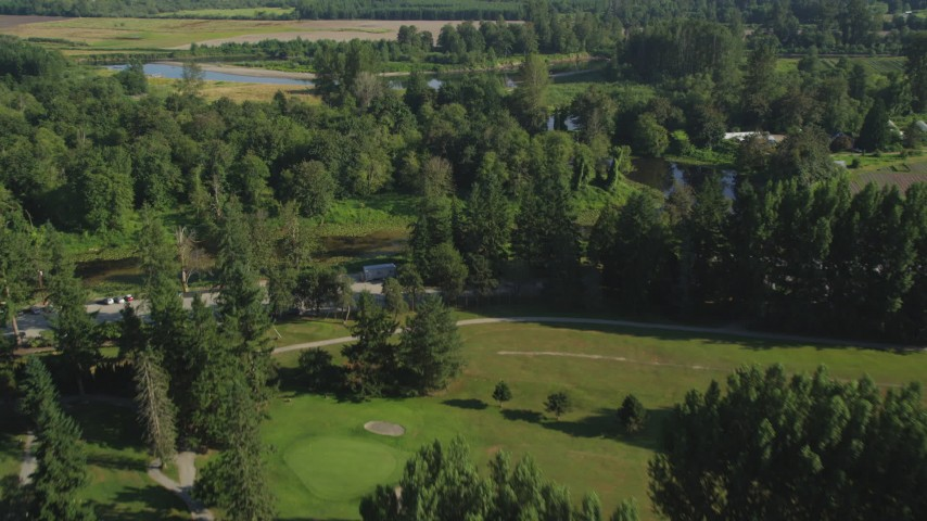 5K stock footage aerial video fly over the Blue Heron Golf Course to approach the Snoqualmie River in Carnation, Washington Aerial Stock Footage | AX48_035