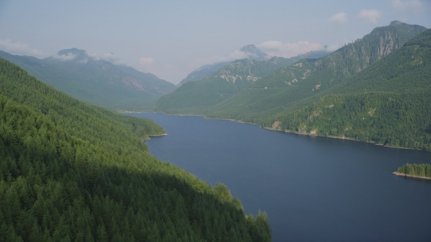 5K stock footage aerial video fly over evergreen trees on mountain slope next to the South Fork Tolt Reservoir, Cascade Range, Washington Aerial Stock Footage | AX48_059