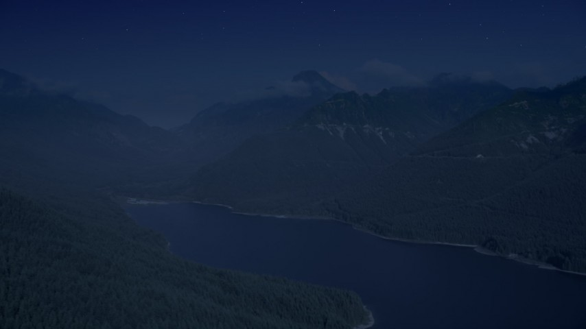 4K day for night color corrected aerial footage of wooded mountain peaks beside the South Fork Tolt Reservoir, Cascade Range, Washington Aerial Stock Footage | AX48_061_DFN